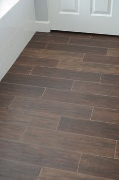 Ceramic tile that looks like wood for the bathroom. Smart!