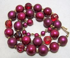 Mid Century wine colored faux pearl bead necklace With red aurora borealis molded glass beads Gold tone hook clasp signed Japan 16.5 inches long, can be shorted 3 inches Very good vintage condition, shows no wear I specialize in vintage beaded jewelry, please visit my shop to see more  International buyers welcome, overcharges are refunded Flat rate priority shipping is optional 21516  Credit cards and Paypal accepted.  Want to see more great necklaces? Click here: https://www.etsy....