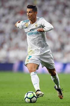 Real Madrid's forward from Portugal Cristiano Ronaldo controls the ball during the Spanish league football match Real Madrid CF against Real Betis at the Santiago Bernabeu stadium in Madrid on September 20, 2017. / AFP PHOTO / GABRIEL BOUYS