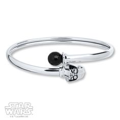 This Star Wars™ bangle bracelet is a fashionable way to display your fandom. Crafted of sterling silver, the bracelet features a round onyx on one end and a Darth Vader mask on the other.  Black Onyx is subject to a dye treatment which may not be permanent.  Gently clean by rinsing in warm water and drying with a soft cloth.