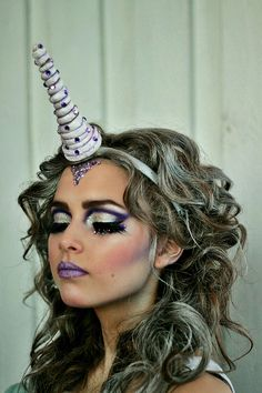 Silver and purple Unicorn inspired fantasy make-up with jewel accents.