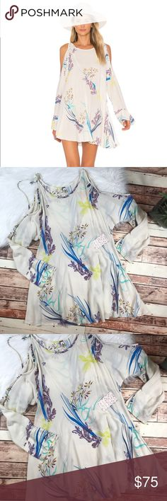 NWT free People clear skies cold shoulder dress Size xsmall, brand new with tags! Adorable cold shoulder styled mini dress! So cute! Length-32, bust-21 pit to pit ***NO modeling or trades! ::428 Free People Dresses