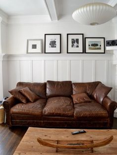 leather couch w/simple beadboard & photo ledge