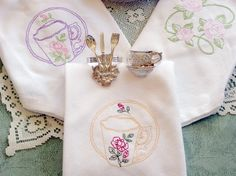 Embroidered Napkins. Love the card holders too.