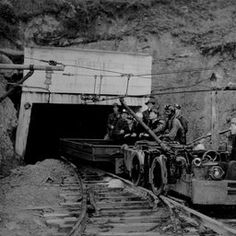Harlan Miners on a mining cart leaving a mine entrance, 1939