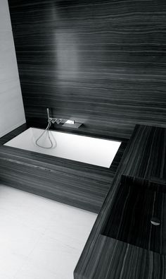 this is similar to stone we are using for bathroom counter top, with white square sinks