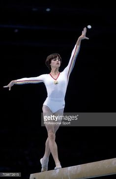 Romanian gymnast Nadia Comaneci pictured in action to win the gold medal on the balance beam during competition in the women's artistic team all-around competition at the 1980 Summer Olympics in the Sports Palace of the Central Lenin Stadium in Moscow, Soviet Union in July 1980. Nadia Comaneci and the Romania team would go on to win the silver medal in the team all-around competition. #gymnastics #gymnast