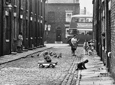 I like this photo but Shirley Baker. I like the black and white to show that its old. I also like the idea of childhood and the children playing games in the street