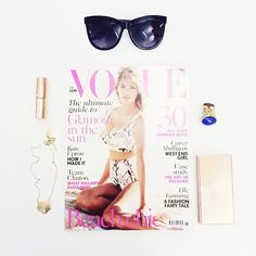 Today's office essentials. @British Vogue + @Charlotte Tilbury + #yslartyring + @Maurício Kenzo Yamasaki necklace. #kenzo #vogue #details #fwis #stilllife #instsmakeup #instastyle #fashion #style #covetique