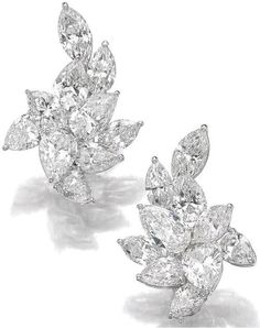 Pair of diamond ear clips.     Each of cluster design, set with pear- and marquise-shaped diamonds ranging from 0.68 to 1.78 carats.    Sotheby's.