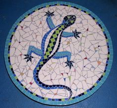 [alligator+mozaiek.jpg] alligator mosaic. Looks like a lazy Susan or maybe a stepping stone..I really like it