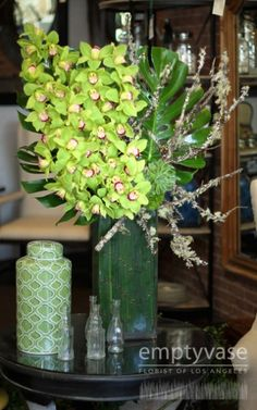 Bring green into any room with this artful arrangement of 50 blossoms of Dutch green cymbidium orchids, dianthus, and a variety of succulents...