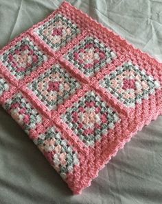 Hand crocheted granny square baby blanket This blanket has been made using dk acrylic baby yarn in fondant, pale pink and candy floss, white and silver The squares have been crocheted together with the candy floss pink and has also been used for the bo. Point Granny Au Crochet, Baby Afghan Crochet, Afghan Crochet Patterns, Baby Knitting Patterns, Hand Crochet, Kids Crochet, Scarf Patterns, Free Crochet, Granny Square Crochet Pattern