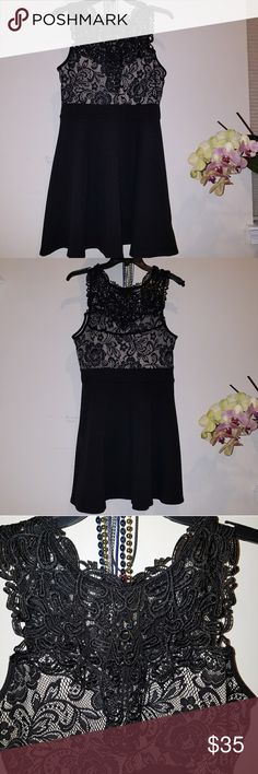 Trixxi Black Lace dress Beautiful piece,  very comfortable and flexible,  perfect condition,  well made lace. Trixxi Dresses Mini
