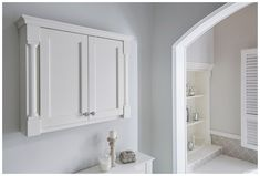 Spacious wall cabinet with decorative pilasters and cornice Fitted Bathroom Furniture, Modular Walls, Timber Furniture, Cornice, Bathroom Colors, Bathroom Medicine Cabinet, Bathrooms, New Homes, Bathtub