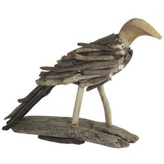 This gorgeous bird is made from recycled driftwood. From: https://www.ecochic.com.au/ecochic/shop/Shop+by+Category/Sale/Driftwood+Bird.html#.U2y0zVfI_fU