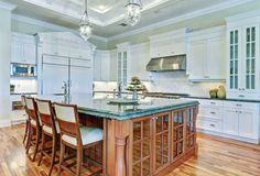 Kitchen with brazillian green granite counter island