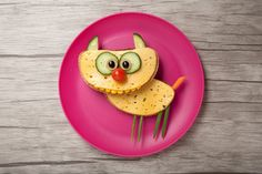 Photo: Funny cat made of bread and cheese on plate and board