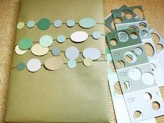 Punch circles from paint chips, attach to string, tie on package.