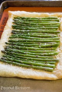 Asparagus and parmesan puff pastry tart: The easiest side dish or appetizer to add to your menu. Love the bright green color and the roasted prep is perfect for the asparagus!