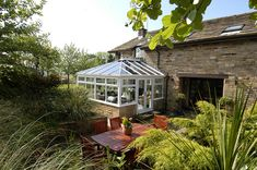 A conservatory extension is the perfect way to extend your living space without moving house. This beautiful white conservatory adds a fresh look to the stone home and complements the garden area perfectly, working well with most home styles. Conservatory Extension, Moving Home, Upvc Windows, Stone Houses, Dark Night, Interior Inspiration, Cosy, Improve Yourself, Living Spaces