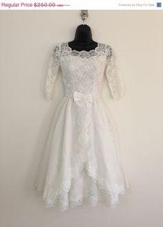 SALE Rocking Down the Aisle // 1950s White Tea Length Wedding Dress. $150.00, via Etsy.