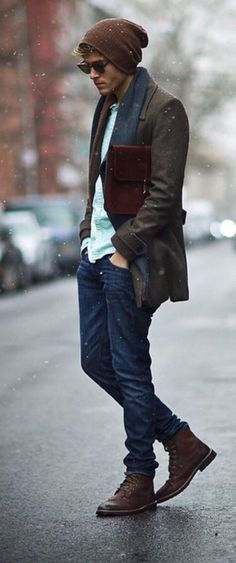 Consider wearing a dark brown overcoat and navy jeans to look classy but not particularly formal. A pair of dark brown leather brogue boots will seamlessly integrate within a variety of outfits.   Shop this look on Lookastic: https://lookastic.com/men/looks/overcoat-long-sleeve-shirt-jeans/15479   — Brown Beanie  — Dark Brown Sunglasses  — Navy Scarf  — Mint Long Sleeve Shirt  — Burgundy Leather Briefcase  — Dark Brown Overcoat  — Navy Jeans  — Dark Brown Leather Brogue Boots