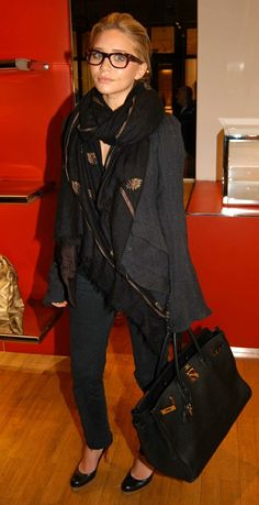 black pants, black heels, layered top look: black under gray with scarf