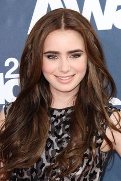 Lily Collins' Hairstyles and Hair Color