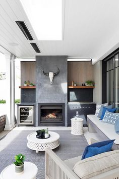 In the outdoor living room and kitchen, the material palette here includes timber shelves made from recycled rail sleepers, teak wall cladding, marble splashbacks and a fireplace in burnished black concrete Australian Garden Design, Australian Homes, Outdoor Rooms, Outdoor Living, Outdoor Furniture Sets, Outdoor Kitchens, Outdoor Areas, Outdoor Decor, Built In Braai