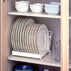 Make your plates easier to grab with a rack that stands them up for you. | 47 Storage Ideas That Will Organize Your Entire House & Wood Plate Rack for Vertical Plate Storage | Pinterest | Plate ...