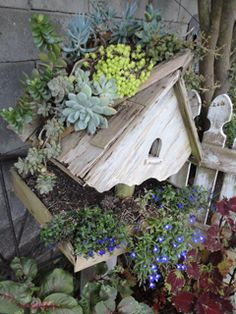 I have a sad bird feeder in the garage that I will transform as a planter like this.