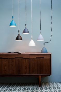Dokka pendant lamp by Birger Dahl 1954.  Reissued in 2007 by Northern Lighting, Norway.  Black, white with matching silk cords, matte aqua green, petrol blue, light grey, dark grey with black rubber cord.  globallighting.com