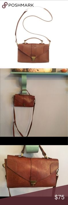 """Lovelock mini crossbody 1937 lovelock mini bag. In good condition. The leather is in great condition but there are a few flaws. Slight wear on the hardware and a mark on the upper flap. Some other minor wear. But so, so adorable. 9""""x6"""" Madewell Bags Crossbody Bags"""