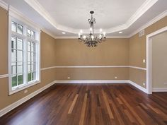 Dining room with tan walls. Dining room in new construction home with tan walls , Flooring, Solid Hardwood Floors, Tan Living Room, New Homes, Wood Dining Room, Home, Tan Walls, Colorful Interiors, Home Decor