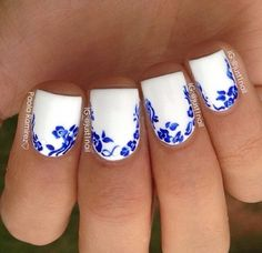 White nails with blue flower accents