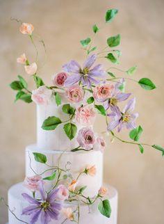 Lilac + blush floral covered cake: http://www.stylemepretty.com/2016/02/29/dreamy-lilac-blush-wedding-inspiration/ | Photography: Jose Villa - http://josevillablog.com/