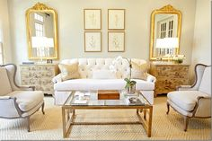 beautiful white living room. louis philip mirrors. Munger Interiors.