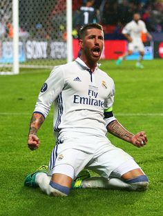 Sergio Ramos of Real Madrid celebrates scoring his team's second goal during the UEFA Super Cup match between Real Madrid and Sevilla at…