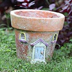 clay pot with fairy door and windows for the girls to plant their favorite plant in.