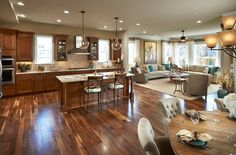 Gleaming wood flooring ties the space together - 6 Great Reasons to Love an Open Floor Plan
