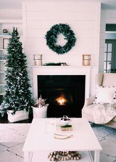: A Simple Christmas home design. Noel Christmas, Simple Christmas, Christmas Fireplace, Slim Christmas Tree, Xmas Tree, Modern Christmas, Rustic Christmas, Beautiful Christmas, How To Decorate For Christmas
