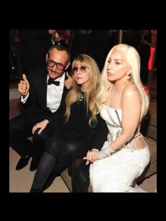 GaGaaaaa in a VERSACE Gown!! LoV ME...Some VERSACE!! BUT Not on her with THAT Make-Up and HAIRRRRRRR!!! NoWWwww, SEE How those Side TaTs LooK in a VERSACE GOWN!!   ~Janaline