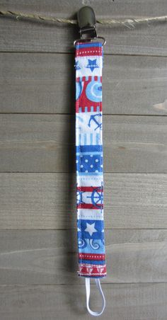 Hey, I found this really awesome Etsy listing at https://www.etsy.com/listing/400208195/red-blue-nautical-pacifier-clip-pacifier