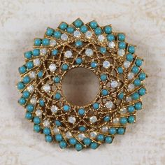 Vintage Sarah Coventry Turquoise and Opal Gold Filigree Circle Brooch by scdvintage on Etsy $28