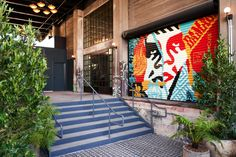 For the last few years, many conversations about Downtown LA have turned to Soho Warehouse in the Arts District. The seven-story, building on S Santa Fe Ave was to be converted into an… Santa Fe, Courtyard Cafe, Graffiti, How To Install Wallpaper, Malibu, Artist Loft, Rooftop Patio, Exposed Brick Walls, Outdoor Restaurant