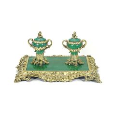 A Victorian silver-gilt and malachite inkstand, John Eldershaw Brunt, London, 1837 shaped rectangular stand cast and chased with naturalistic flowers, foliage and bees, fitted with two silver-gilt mounted and lined inkwells, hinged domed covers, foliate scroll handles leading to floral swags, acorn finials , 11in wide