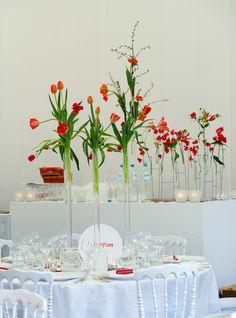 I like these tall slender minimalist flower arrangements.