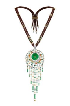 Chow Tai Fook - The Meadow necklace - The Cambodian diverse ecosystem comes alive in this set of three adorned by natural green and red jade, icy jade, white and yellow diamonds, all set in 18K yellow and white gold.