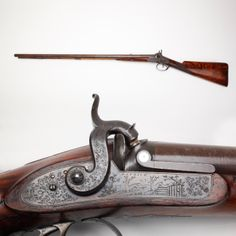 Ann Patrick Double Rifle - Our GOTD is a percussion double rifle built by Ann Patrick of Liverpool. With big .70 caliber bores, this double rifle was likely manufactured when Ann Patrick had her shop from 1820-1830 at 44 Strand Street and was the daughter of Jeremiah Patrick, a noted flintlock gunmaker of Liverpool. The unique engraving on this piece also gives you the chance to see something looking back to you when you examine the patchbox. At the NRA National Firearms Museum in Fairfax, VA.